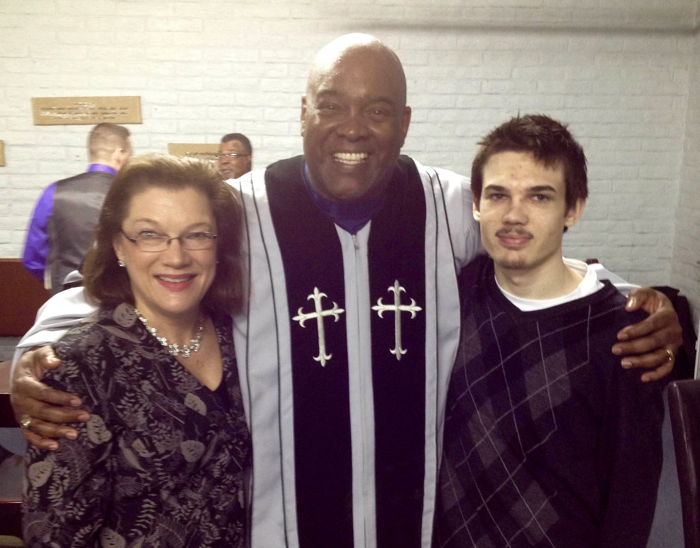 Mary and our son Benjamin with Dr Angulus Wilson, lead pastor at New Beginnings Community Baptist Church in Fresno